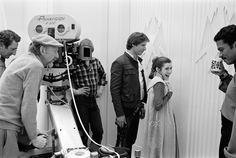 Han with Princess against a wall
