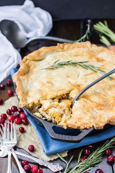 Turkey pot pie made from scratch in a cast iron skillet with sweet potatoes and rosemary -- a great way to use up leftover turkey from Thanksgiving!