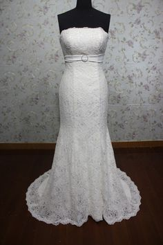 elegant ivory strapless empire mermaid lace wedding dress. $228.00, via Etsy.