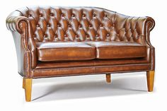 The Tiffany 2 Seater Chesterfield Sofa based on the Tiffany Tub Chair handmade in Antique Tan leather with button back and cushion seats. Solid hardwood frame traditionally handmade with sprung back and seat. Finished in Antique leather that is 100% Top Grain Leather and carries a Lifetime Guarantee. Solid wood Georgian legs in Yew wood finish. Handcrafted in England by time served craftsman. Measuring (LxDxH):135x88x85cm. Custom sizes are available.