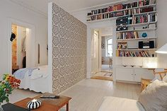 small apartment ideas - love all the books on the shelf.