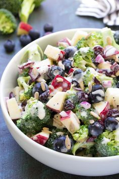 The best ever No Mayo Broccoli Salad with Blueberries and Apple! A healthy and easy summer side dish with a creamy poppy seed dressing and dried cranberries.
