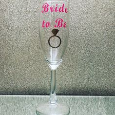 A personal favorite from my Etsy shop https://www.etsy.com/listing/481849479/1-bride-to-be-champagne-flute-he-put-a