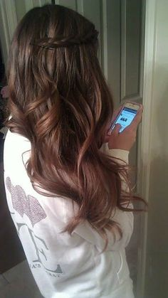 brown hair side twist. i like how it looks more red as it gets to the ends.. kinda like if you had it blonde on the ends only its a reddish brown