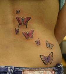 Small butterfly tattoo on lower back. To check out more cool butterfly tattoos and various other tattoo designs and tattoo ideas, check out www.tattoovault.com/