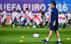 England coach Gary Neville pictured on the pitchat the Stade des Bourgognes in France with the start of Euro 2016 nearing
