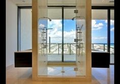 Imagine the views as you shower in six-bedroom/seven-bathroom penthouse in Apogee South Beach, one of the most desirable condominiums in Miami Beach. The unit, which is listed for $25 million, features a room-for-two steam shower with unobstructed ocean views, thanks to its all-glass walls