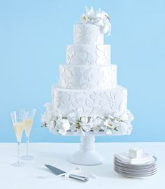 White Embossed Flower Wedding Cake Playing with your cake's dimensions can be a low-cost way to make a high-design statement. Round confections are the longtime favorite, but lots of couples are choosing square, oval or rectangular cakes for an unexpected twist on tradition. Asymmetrically placed tiers and layers of varying depths are other outside-the-box options. 1 of 2