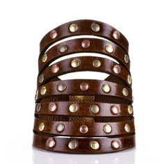 brown rivets leather cuff by Daniela Zagnolli. Great statement piece. Available at Lion'esque Style $45