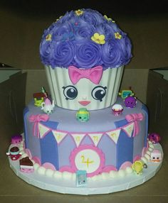 My second Shopkins cake. The design was based on a picture my coworker sent. The giant cupcake liner was made of white chocolate using the pan as a mold, and the shopkins are actual shopkins. The face and all other decorations were done by hand.