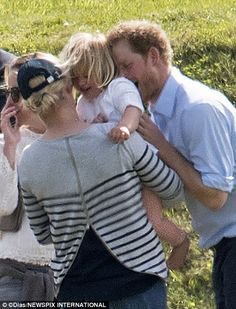 Naughty Uncle Harry is such a great giggle: Mia squels with delight as the prince blows raspberries on her neck
