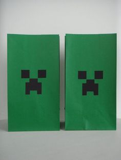 Minecraft birthday party favor treat bags - just black squares of construction paper on green bags.