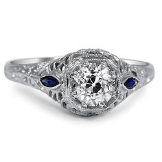 The antique setting, the blue stones, Edwardian style from 1910s... perfect  The Faunus Ring from Brilliant Earth http://www.brilliantearth.com/The-Faunus-Ring-White-Gold-BMC98513/