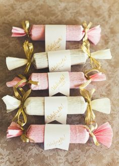 light pink party favors. ribbon ~ bow ~ cream ~ gold    Little parcel ideas in crepe paper