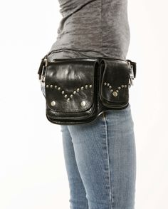 This beautiful black leather and chrome hardware utility belt is edgy and goes great with every style. A beautiful riveted design is featured on both pockets. The soft leather conforms to your waist. The adjustable straps ensure a perfect fit for any size. This utility belt is handmade with the best quality on the market. This holster type storage belt features two separate snap closure storage pouches and one large interior zippered compartment. One of the largest storage belts on the…