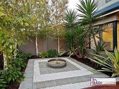 Low Maintenance Front Garden Ideas Australia modern garden design using timber with deck & decorative lighting