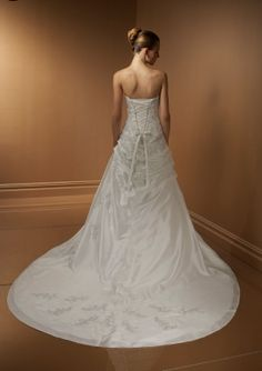 This stunning A line gown flows to the floor with at drape at the left and a slight pickup at the right. With a wide laced corset and ties hanging over the tiers of taffeta, draping continues down the back of the skirt and opens into a stunning chapel train. You will look beautiful...just as you wanted to...and the man of your dreams is dreaming of love! #timelesstreasure