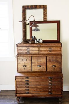 wow, that's what my little drawers need--a couple of cool mirrors and a gooseneck lamp.