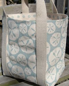 Sand dollar tote in sea spray, $50. Getting married by the shore this summer? Thank your maids for their love and support by gifting each of them with this sturdy silk-screened tote bag. Fill it with flip flops, a towel, and one of your favorite beach reads, and they'll tote it with them to the beach for years to come.  Shop This Etsy Crafter  See More Like This