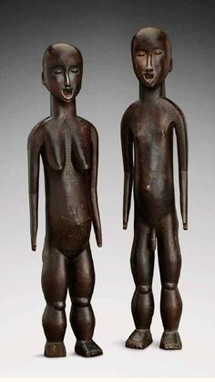 Africa | Ancestral couple from the Yao people of Malawi | Wood; reddish brown patina   || Source; http://issuu.com/artsolution/docs/6-tfa_int-low