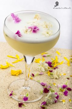 Jasmine Tea White Lady -  Gin, fresh lemon, jasmine tea syrup, cointreau, egg white Served in a coupette and garnished with jasmine & edible flowers