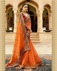 Orange soft silk beautiful sari paired with a heavy embroidered blouse. This sari is beautified with heavy embroidery work and lace border. It comes with unstitched blouse. This sari measures 5.5 meter, including a 0.8 meter blouse piece.