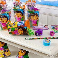 Dora Party Ideas: Favors  **I did something very similar for my daughter's school party and they turned out really cute.  Party City has the cups and pencils, plus bubbles, stickers, and more**