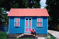 Payne's Bay, Bardados Man sitting on steps of Chattel House, Payne's Bay.    Read more: http://www.lonelyplanet.com/barbados/images/payne-s-bay-bardados$23940-39#content#ixzz2h5JK3oJZ