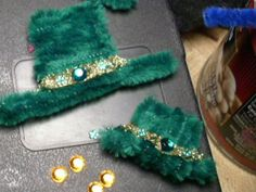 Made Saint Patrick's day pins out of fuzzy pipe cleaners, flat back rinestones, and tiny green flower nail rinestones and added a band of gold glitter to really make it pop.