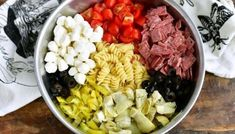 ingredients for antipasto pasta salad laid side by side in a mixing bowl Homemade Macaroni Salad, Macaroni Salad Ingredients, Macaroni Recipes, Antipasto Pasta Salads, Pasta Salad Recipes, Macoroni Salad, Greek Tortellini Salad, Apple Cranberry Salad, Southern Potato Salad