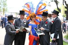 Bright: A colourfully dressed lady shows off her bold orange and royal blue ensemble from ...