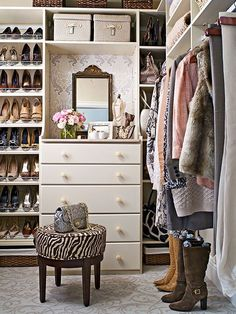 Scooting a dresser into the closet is a smidge of storage smarts that needs to catch on in a major way. Not only does it put drawers right where you need them, but it also provides a flat surface at just-right jewelry-donning, mirror-gazing, lipstick-swiping height. Elegant metallic wallpaper adhered to the inside wall provides a pop of pattern. We also love that this snug space utilizes even the tiniest crevices for storage, including areas near the ceiling and on the floor.
