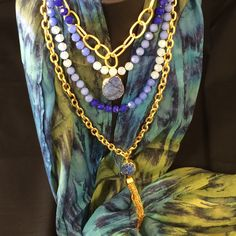 Beauty is on the inside, but these fabulous gold and purple necklaces never hurt the cause!