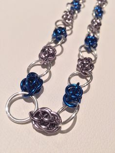 A personal favorite from my Etsy shop https://www.etsy.com/ca/listing/270704151/gunmetal-and-navy-blue-chainmaille