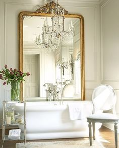 """I wanted to create an elegant backdrop with jewelry-like touches,"" says #NewTrad designer Amy Morris. Click the link in our bio to see more of the Atlanta home. : Emily Jenkins Followill. #bath #tub #mirrormirror"