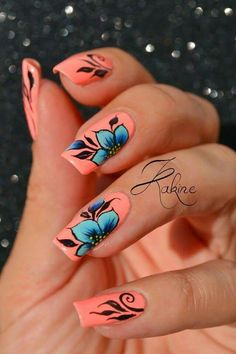 Coral pink nails with blue flowers