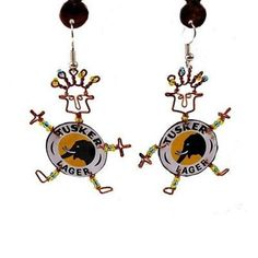 Delightful dancing girl earrings with bodies of Tusker lager bottle caps are accented with copper wire and colorful Maasai beads. Earrings hang approximately 1.5 inches from lead free silver metal hoo