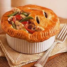 This filling is definitely not peas and hard carrots and tough chunks of chicken. Instead, there are sun-dried tomatoes and shiitake mushrooms with flavorful pieces of thyme-seasoned chicken.         And best of all, the individual pies can be assembled a day ahead, leaving only the baking to be done before sharing them with the family.