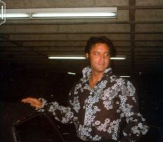 "UNDERGROUND PARKING PHOTO CANDID on Thursday, July 30 1970 - Elvis was rehearsing at RCA Studio C in Hollywood, CA for his ""Summer Festival"" (August 10 - September 8) at the International Hotel in Las Vegas, NV. Watch the documentary film ""Elvis: That's the Way It Is"", directed by Denis Sanders, which combines on-stage, off-stage and behind-the-scenes footage of him. Interesting sidenote: This shirt is in the museum in Tupelo."