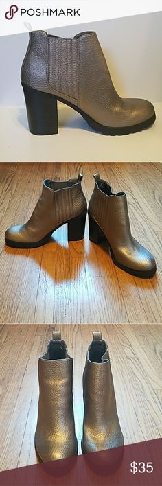 Sam & Libby Deanna Golden Boots. Sam & Libby Deanna Golden Boots. New without tag or box. Only worn inside. Color is a metallic gold. Size 8 1/2. Feel free to ask any questions before purchase. Bundle & Save. Reasonable offers considered. Sam & Libby Shoes
