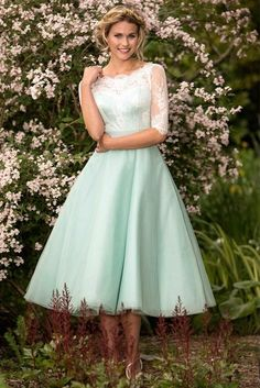 f1846d8412c Sassy tea length bridesmaid dress with a delicate sheer lace neckline and  sleeve