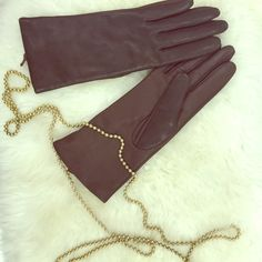Brown Genuine Leather Gloves Beautiful brown leather gloves. 100% genuine leather with 100% cashmere lining. Never used. Still have tags attached. Size 6.5 and would fit a small hand. Fownes Accessories Gloves & Mittens