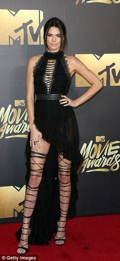 03f819d4ac5dde Leggy look: Kendall Jenner stunned in a halterneck gown with sexy lace-up  stilettos