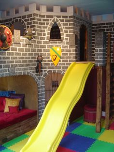 Castle Playroom With Yellow Slide. Love the unique look and feel of the built in castle with slide.