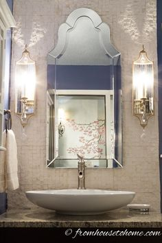 Split faced tile and a Venetian mirror help this bathroom feel more expensive than it was. | 10 Easy Ways To Make Your House Look More Expensive