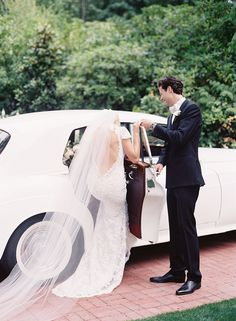 Brita and Richie's Stunning Pacific Northwest Wedding by O'Malley Photographers | A vintage car was the perfect wedding exit for this elegant bride and groom.