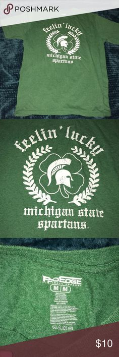 Michigan State University Fellin' Lucky T-shirt Michigan State University Fellin' Lucky T-shirt. Great for St Paddy's day! Very soft. Has been loved but in good condition! PRO EDGE Tops Tees - Short Sleeve