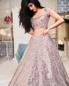 For the ladies who have an undying love for mirror work, this is the perfect lehenga for you. The lehenga skirt and the blouse, both look phenomenal with the mirror embellishments. Party Wear Indian Dresses, Indian Fashion Dresses, Indian Bridal Outfits, Indian Bridal Lehenga, Indian Gowns Dresses, Party Wear Lehenga, Dress Indian Style, Indian Designer Outfits, Pakistani Bridal