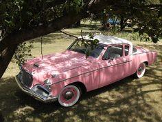 A glamorous pink Studebaker Hawk.