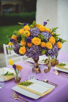 Purple Wedding Table Centerpiece and Decor with Yellow Accents